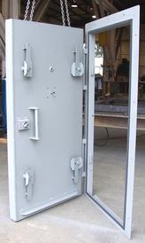 Blast doors for high pressure explosive blasts